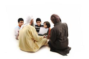 Teacher with children using laptop