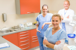 Team of dentist and nurses posing at dental surgery