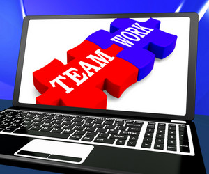 Team Work On Laptop Shows Unity