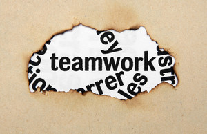 Teamwork Text On Paper Hole