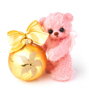 Teddy bear in classic vintage style with christmas toy