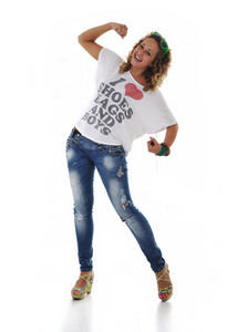 Teen girl laughing and standing on isolated white background