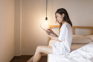 Teen girl play tablet in bedroom