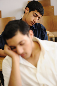 Teen student sleeping at classroom
