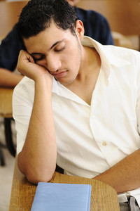 Teen student sleeping at lecture time, college