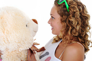 Teenage girl holding a teddy bear (no name or trademark)