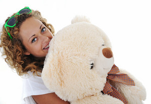 Teenage girl holding a teddy bear