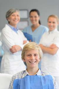 Teenage patient professional dentist team checkup at dental surgery