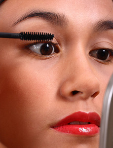 Teenager Applying Mascara To Her Beautiful Face