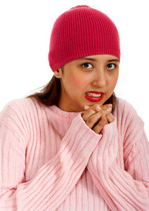 Teenager In Hat An Jumper Feeling Cold