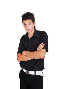 Teenager with his arms folded
