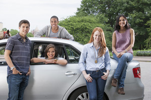 Teenagers with car