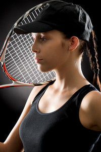 Tennis woman portrait female player with racket on black background