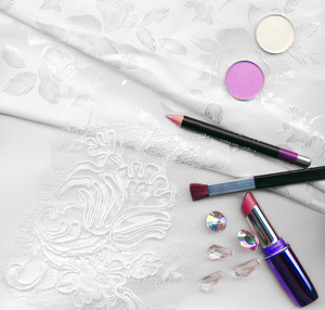 Textile Wedding Background And Makeup For The Bride-