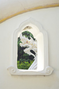 Thai style dragon on white wall