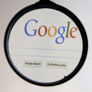 THAILAND - SEPTEMBER 2, 2014: Magnifying glass of Google search page view on web browser.