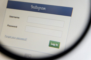 THAILAND - SEPTEMBER 2, 2014: Magnifying glass of Instagram log in page website view on web browser.