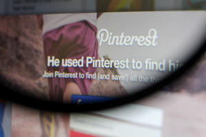 THAILAND - SEPTEMBER 2, 2014: Magnifying glass of Pinterest page first landing page view on web browser.