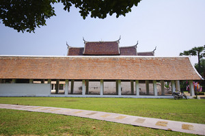 The Beautiful roof of temple on blue sky background with green grass
