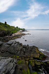 The coast of Newport Rhode Island as seen from the bottom of the famous 40 steps on the cliff walk.
