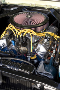 The engine bay of a classic muscle car.
