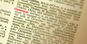 The Meaning Of The Word Christmas Highlighted In The Dictionary. Shallow Focus