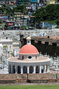 The outer walls of El Morro fort and Santa Maria Magdalena de Pazzis colonial era cemetery located in Old San Juan Puerto Rico.