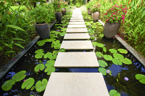 The Stone block walk path in the garden on water