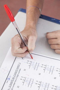 the teacher checking the homework