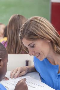 The teacher teaching to pupil