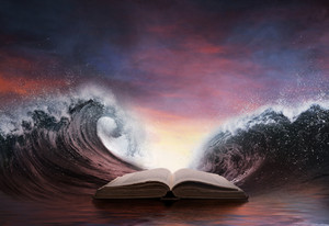 The waves of the ocean are surrounding a book