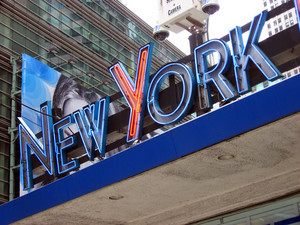 "The words ""New York"" on a neon sign found in Times Square."
