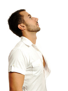 Thoughtful casual man looking up - isolated over a white background