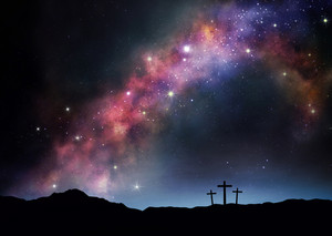 Three crosses on a hillside under the milky way.