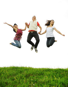 Three friends jumping together outdoor