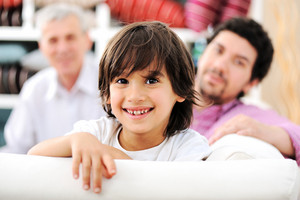 Three-generation happy family portrait at home