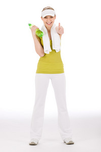 Thumbs up fitness teenager happy woman in sportive outfit