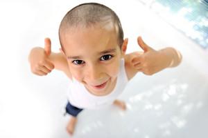 Thumbs up! Little boy, cute short hair, almost bald :)