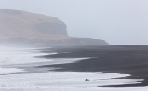 Tide along a foggy beach