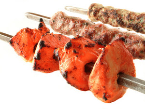 Tikka Kofta And Shish Kebabs On Skewers Against White