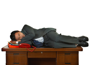 Tired Businessman Having A Sleep