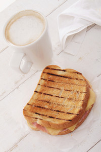 Toasted Cheese And Ham Sandwich With Coffee