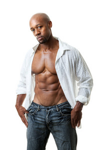 Toned and ripped lean muscle fitness man wearing an open shirt and jeans isolated over a white background.