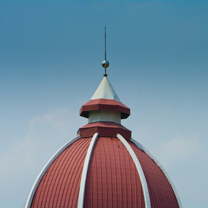 Top of red dome with cloud and blue sky