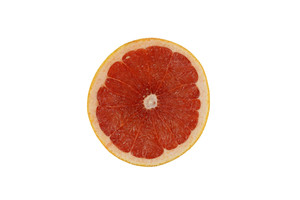 Top View Of A Half Cut Grapefruit On White Background