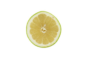 Top View Of A Half Cut Green Grapefruit On White Background