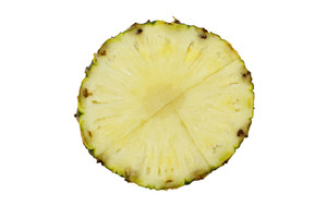 Top View Of A Pineapple Slice On White Background