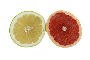 Top View Of Half Cut Grapefruits On White Background