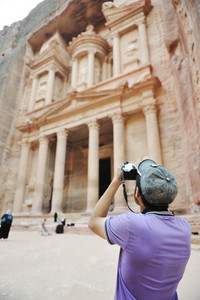 Tourist taking a photo of old  historical building (Petra, Jordan)