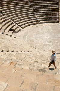 Tourist Woman Walking Around Ancient Amphitheatre